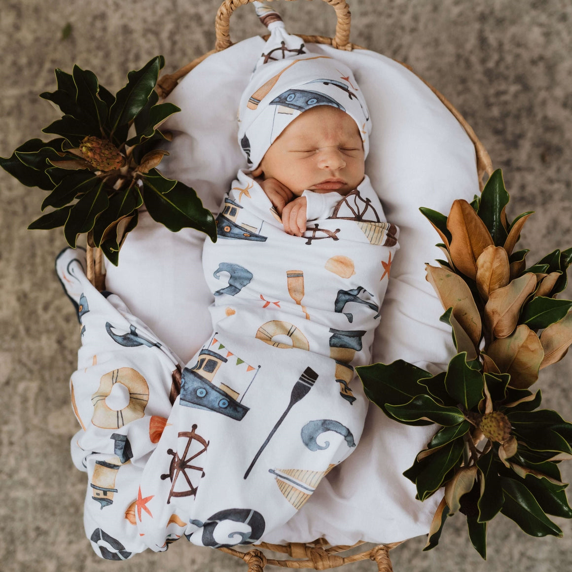 Baby wrapped in the shipwreck jersey swaddle and beanie