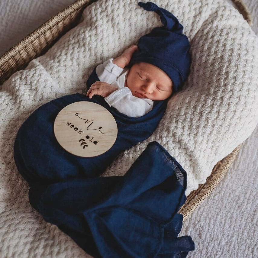 Navy Snuggle Swaddle on newborn baby