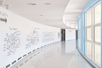 IdeaPaint Pro Professional Grade Dry Erase Paint (Whiteboard Paint) in a hallway at a corporate building