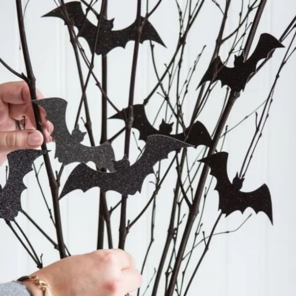 Halloween Centrepiece with Black Glitter Bat Cutouts on Twigs I Halloween Party Ideas I My Dream Party Shop Blog