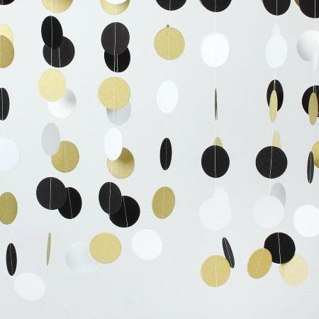 Bunting with Black, White and Gold Circles hanging as a backdrop I My Dream Party Shop I UK