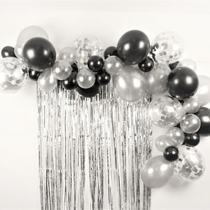 1 metre cotton with decorated white balloons of various sizes on black