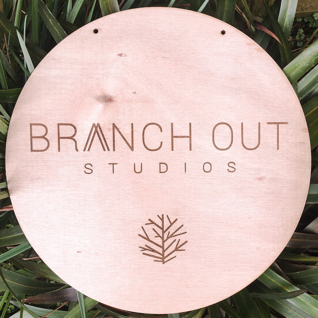 Large circular logo plaque