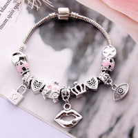 Antique Silver Charm Bracelet & Bangle with Lips and Lock Pendant