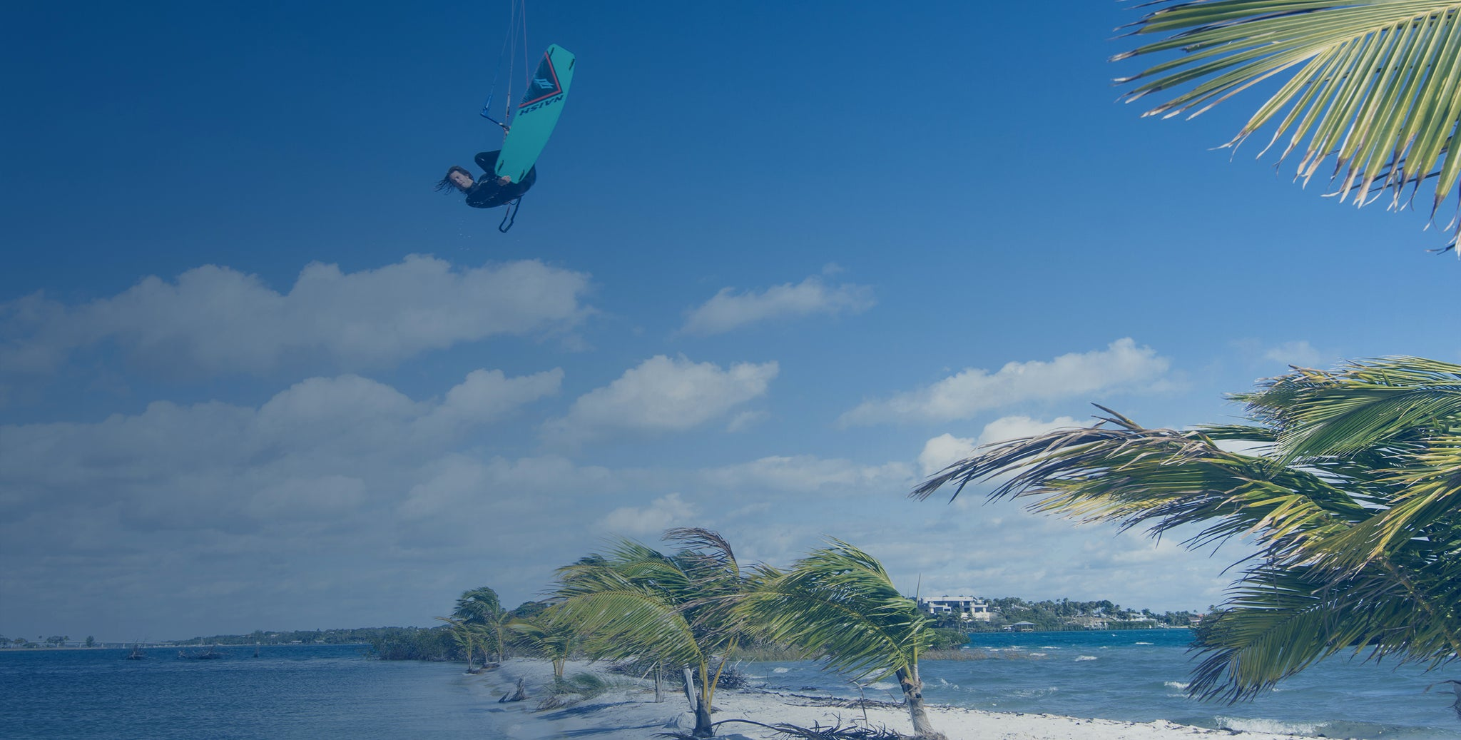 Kiteboarder getting huge air in tropical paradise in Stuart, Florida