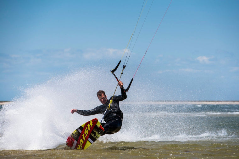 Spray turn kiteboarding at Pocomo Point in Nantucket, MA