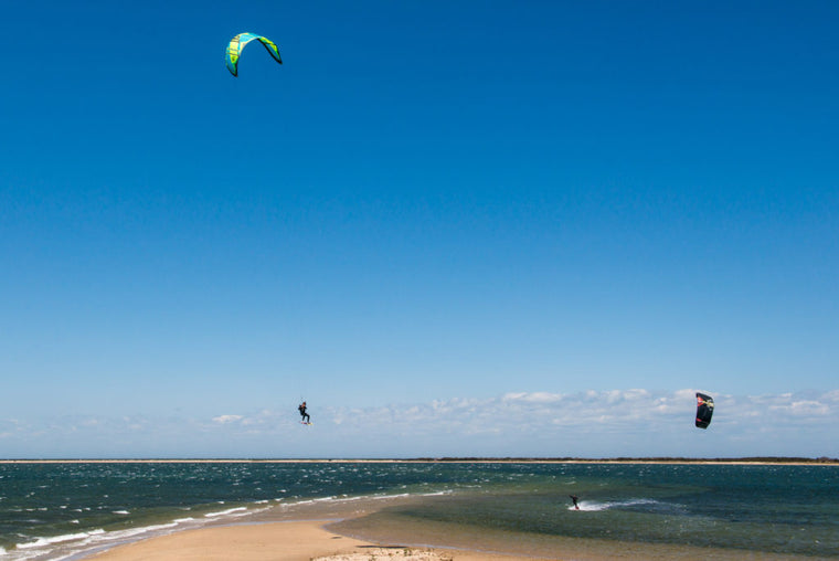 Jumping over Pocomo sandbar while kiteboarding on Nantucket Island