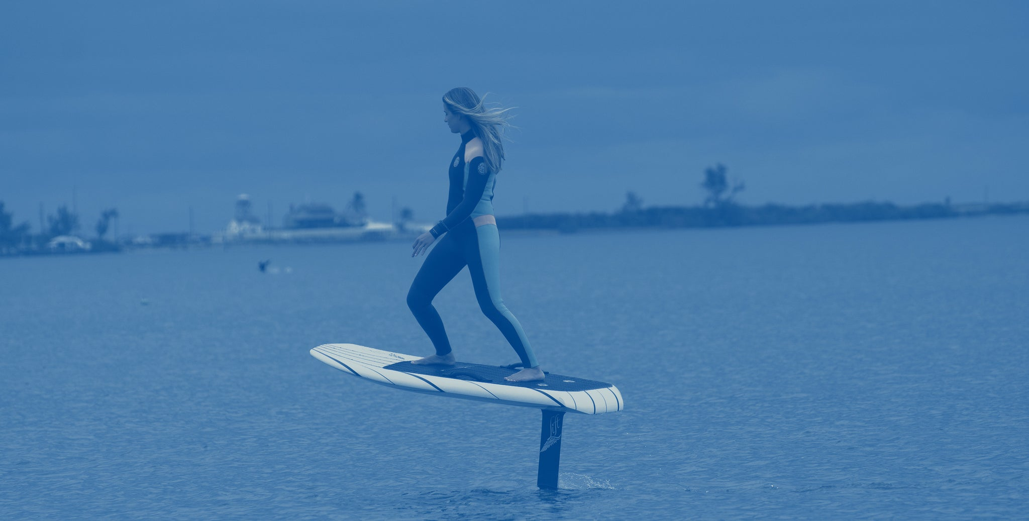 Girl flying on a electric hydrofoil in Jupiter Florida