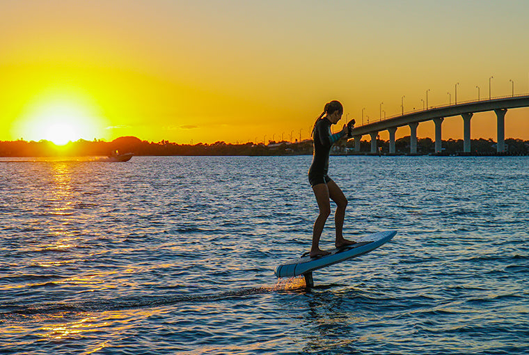 Kelsy Waack riding the efoil with Next Level Watersports in Stuart, FL