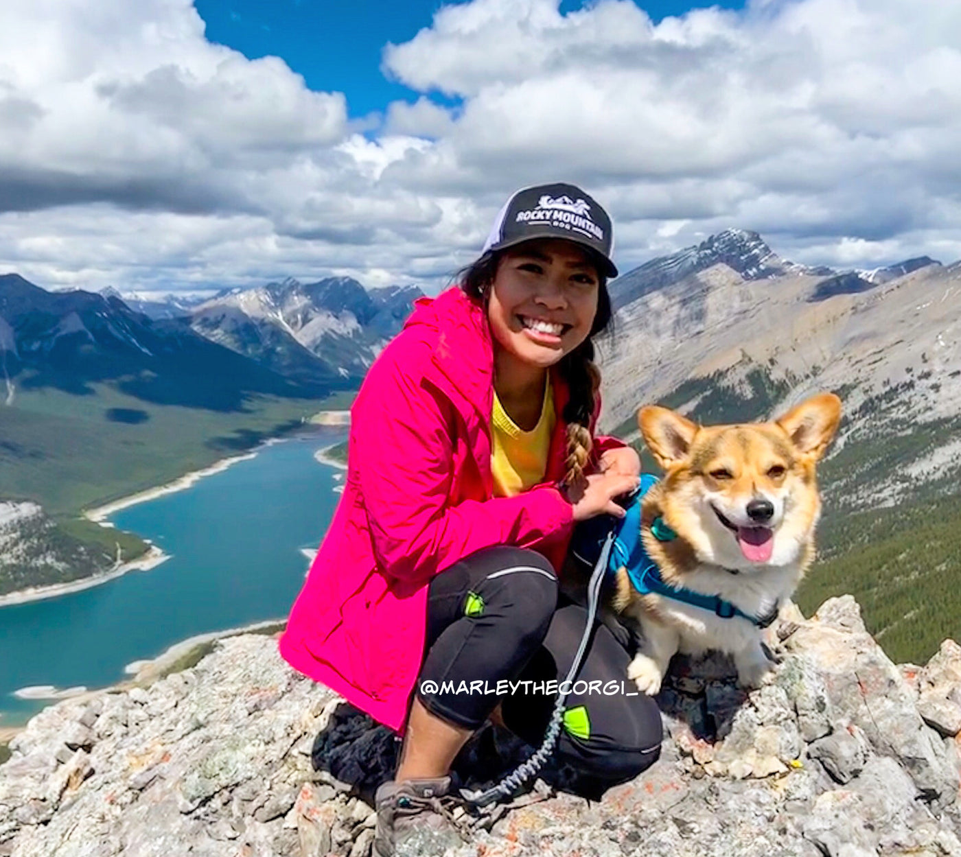 woman and dog corgi hiking mountains kananaskis alberta