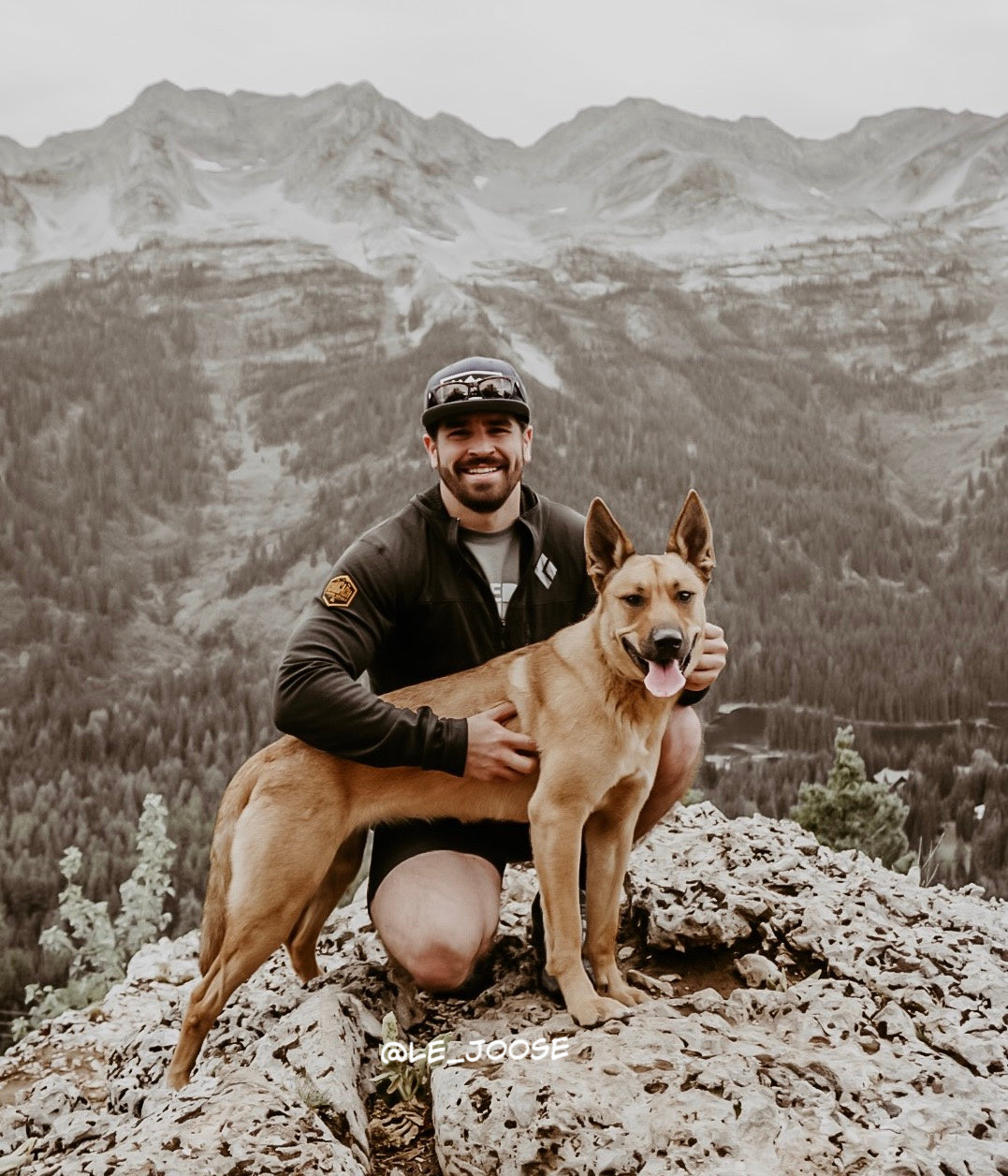 man hiking with dog fernie bc