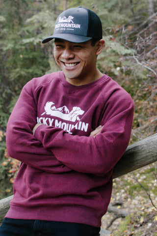 male wearing RMD crewneck sweater