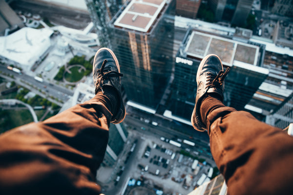Adrenaline Feet Over Edge of Skyscraper