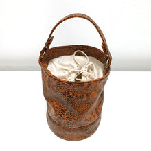 ORANGE SNAKE BUCKET BAG