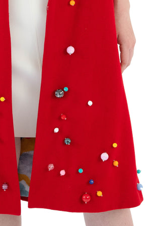 Close up of red opera coat with bead trim