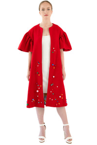 Front view of women's red opera coat