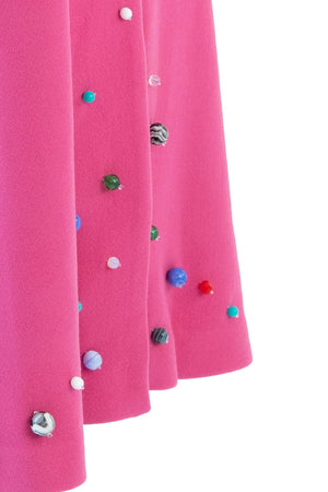 Close up of hand beaded pink opera coat