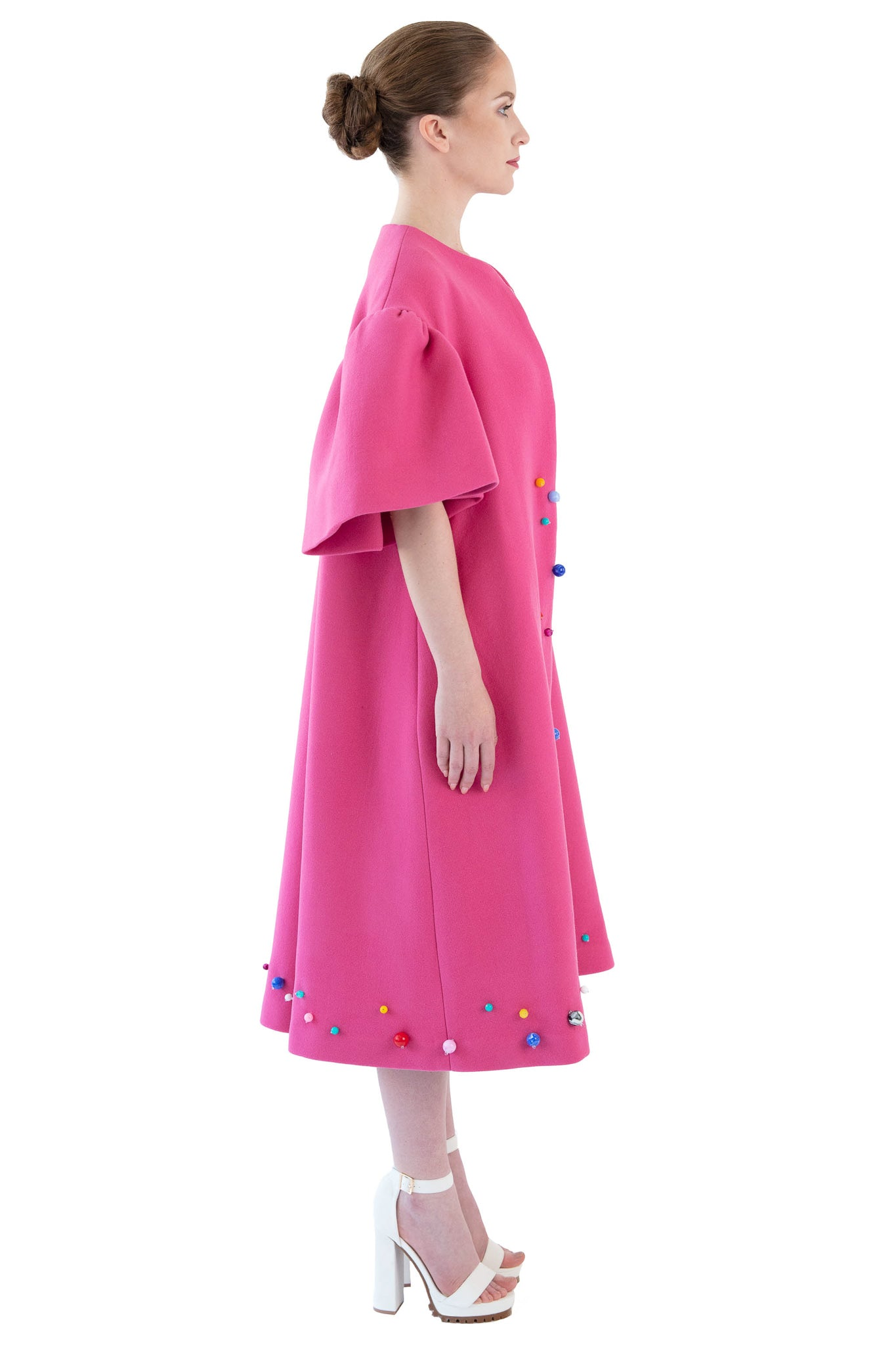 Side view of women's pink beaded opera coat with bell sleeves