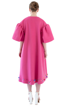 Back of women's pink opera coat