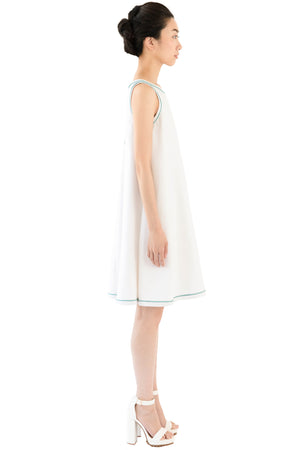 Women's pebbled white dress with blue trim