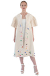 Front of women's white beaded bell sleeved opera coat