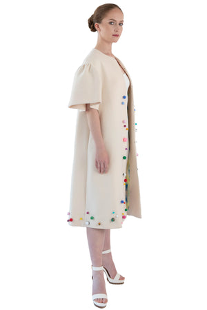 White hand beaded opera coat with bell sleeves