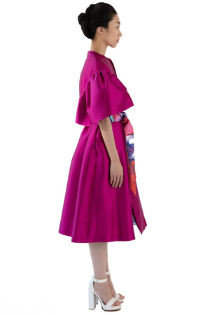 Side view of belted fuchsia opera coat