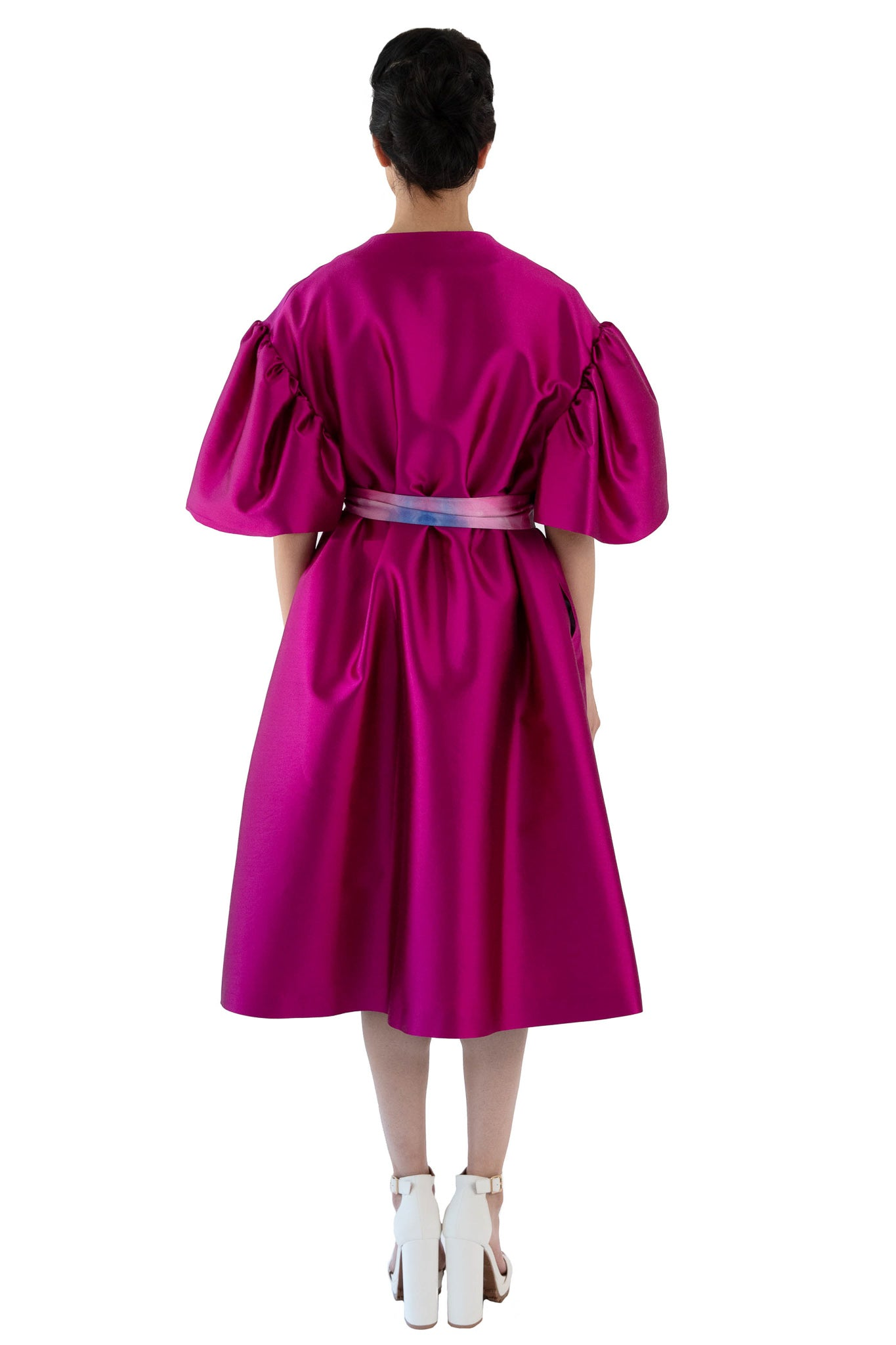 Back of fuchsia opera coat with printed belt