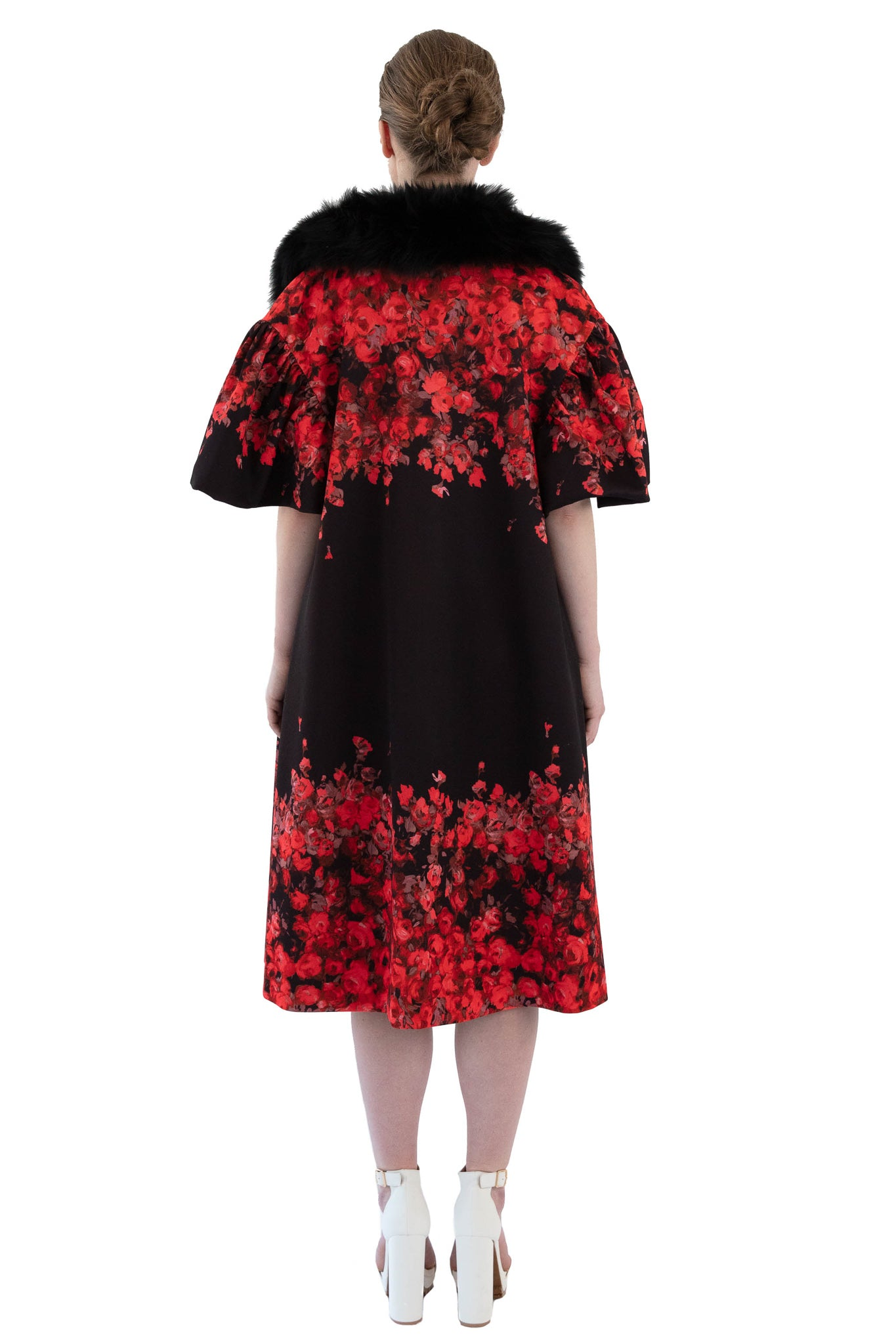 Back of women's red and black floral opera coat with removable fur collar