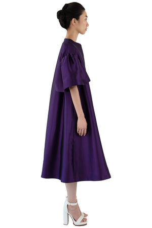 Side view of purple opera coat with bell sleeves