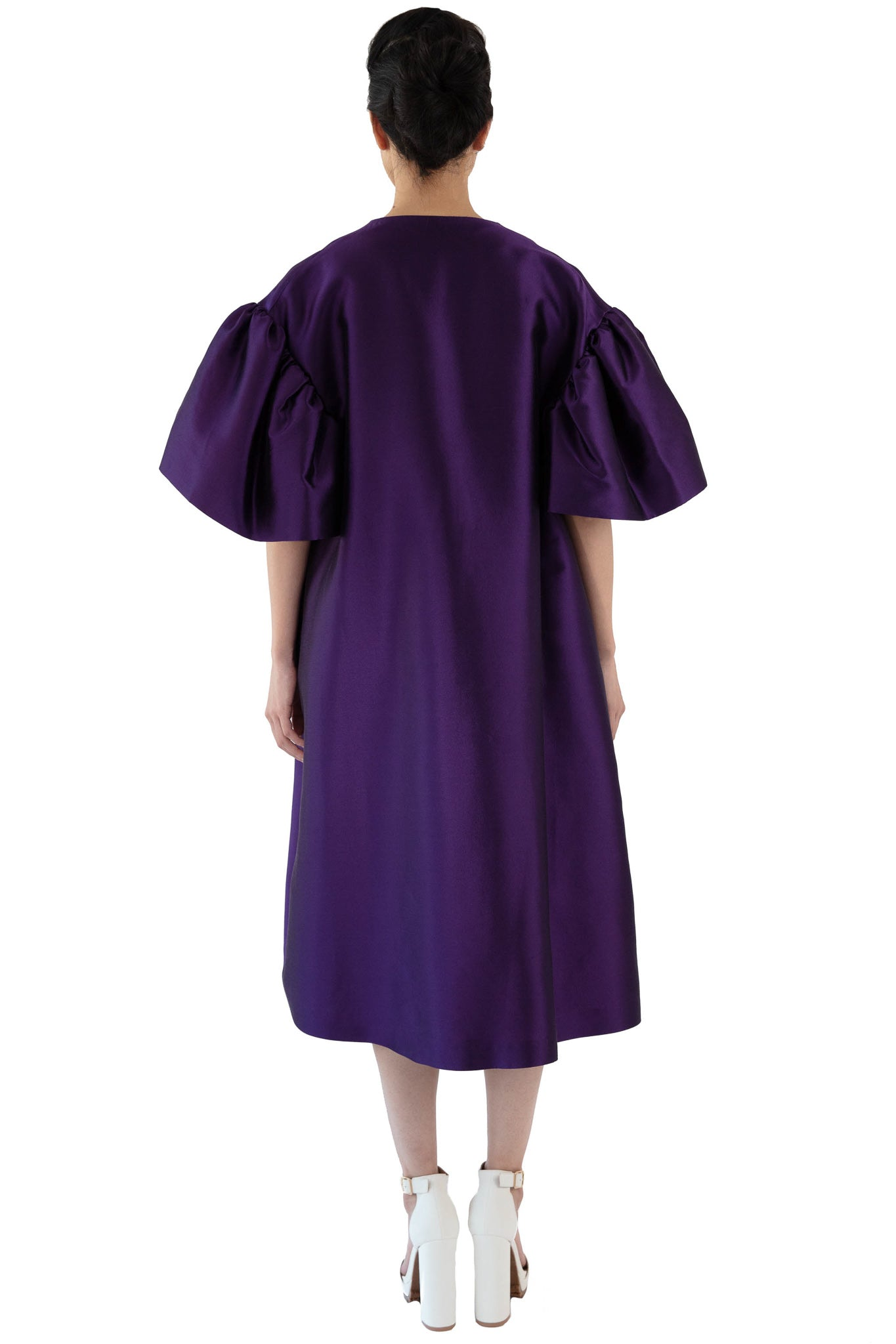 Back of women's purple opera coat