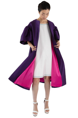 Purple opera coat with fuchsia lining