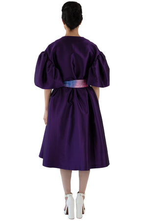 Back of women's belted purple opera coat