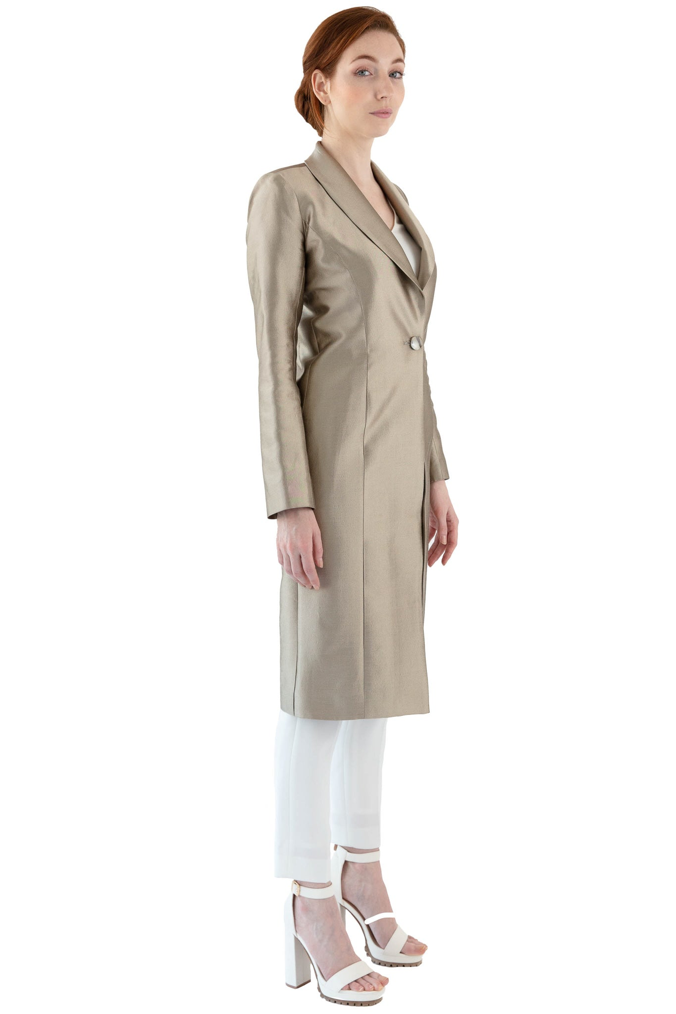 Front of women's shawl collar coat in vibrant gold