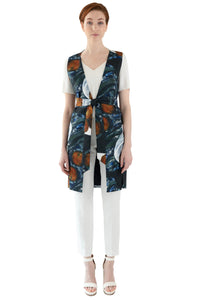 women's vest in still life print with adjustable belt at waist