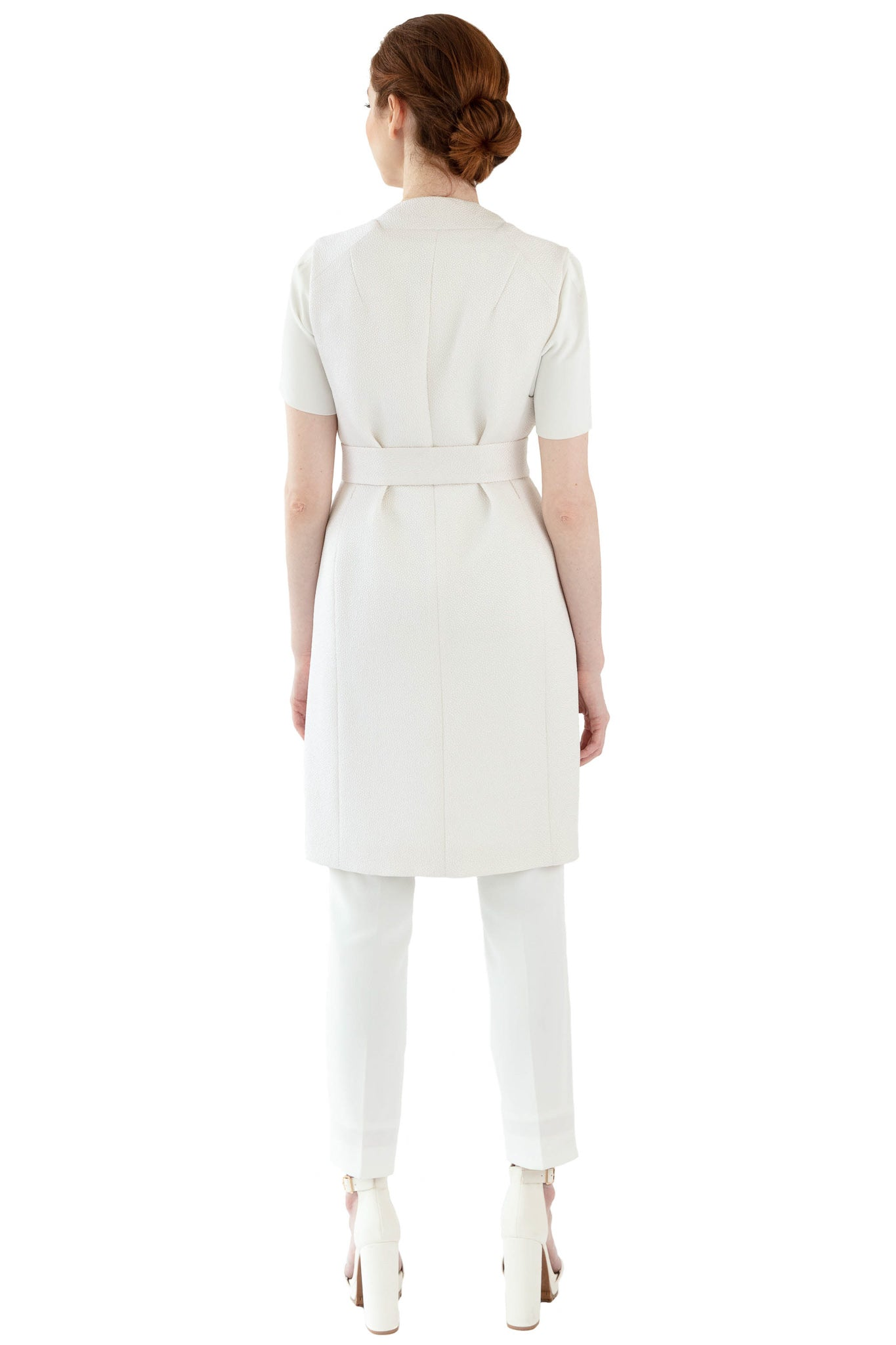 Back of women's bright white vest with tie at waist