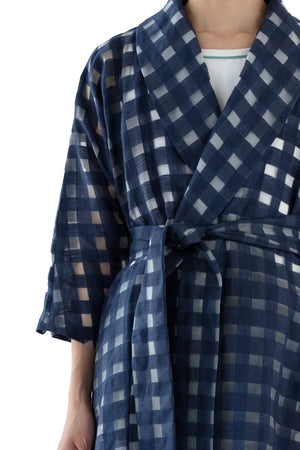 Close up of belted navy wrap dress