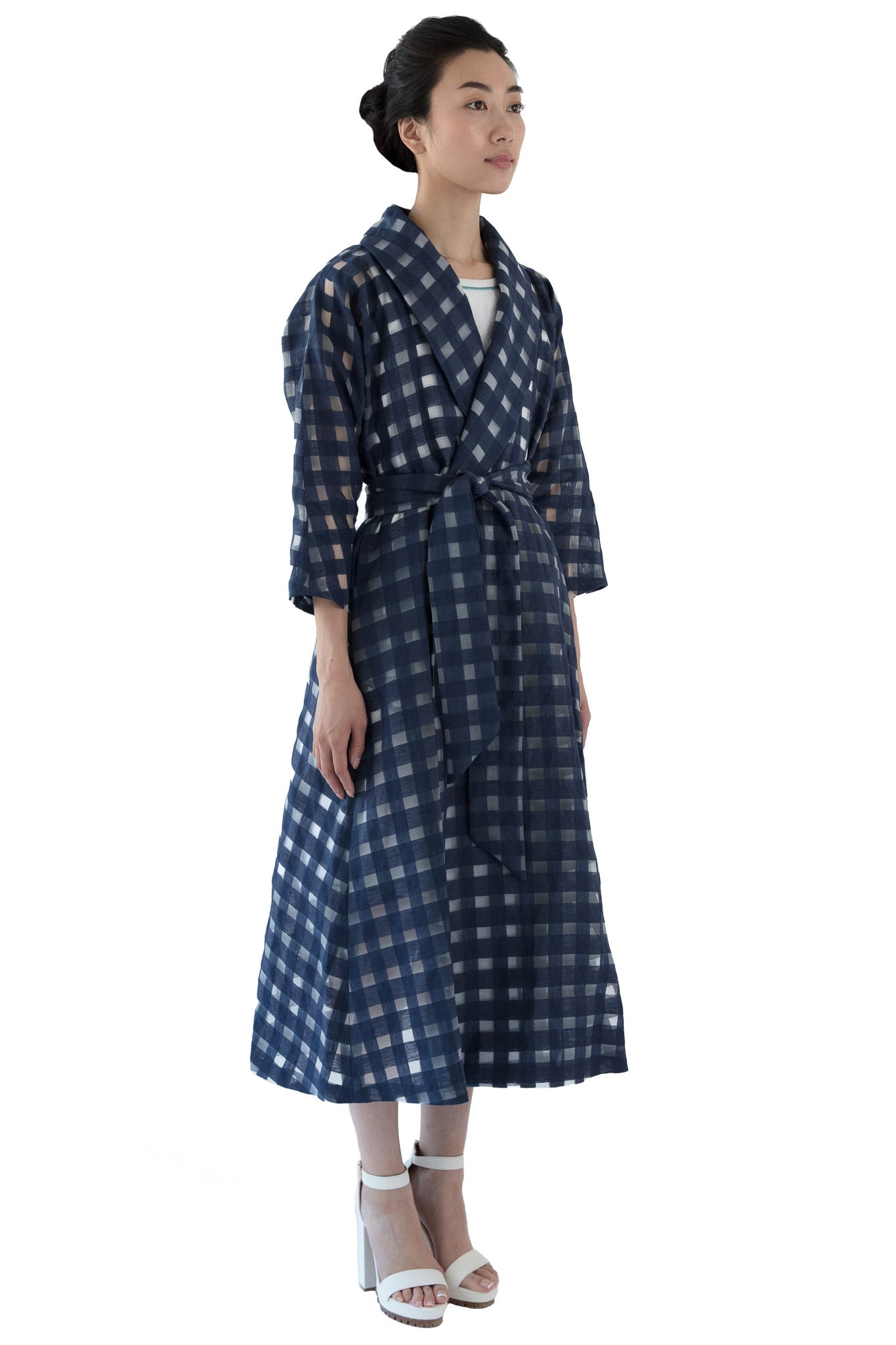Side view of belted navy window pane wrap dress
