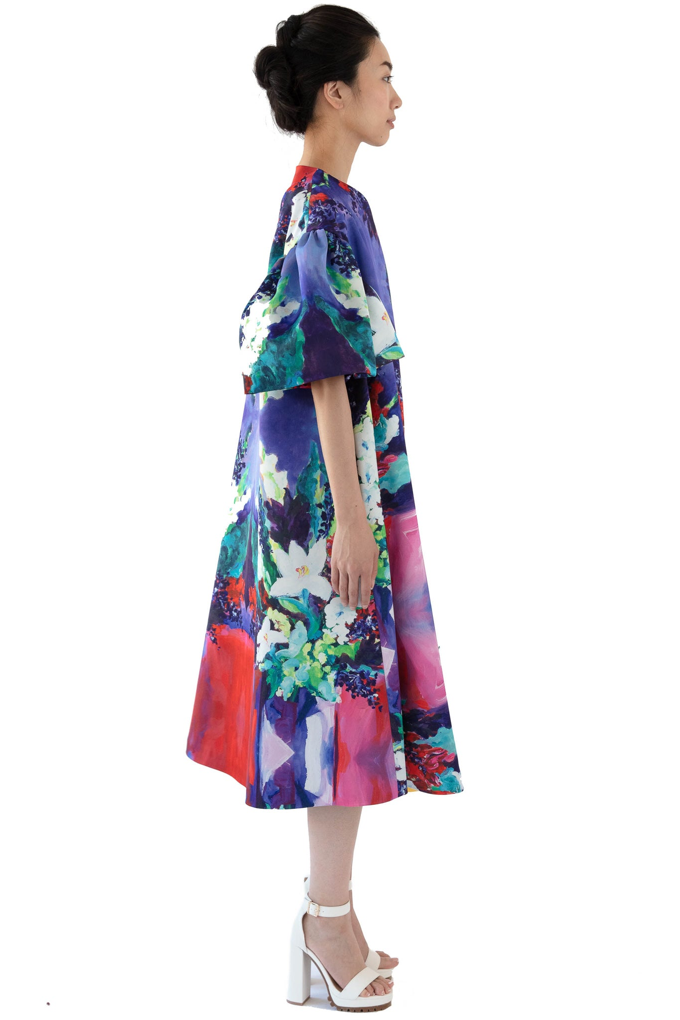 Side of women's printed opera coat in floral