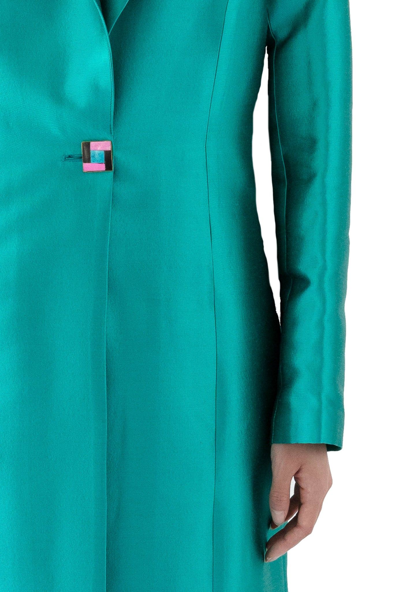 Close up of women's turquoise coat with multi colored button