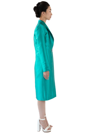 Side profile of women's turquoise coat