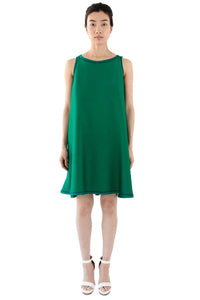 Front view of women's green trapeze dress