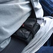 Installs in the lap area and holds the shoulder belt firm.  Lap belt stays tight. Your safety is improved.