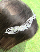 Load image into Gallery viewer, An close up image of the Alita Bridal Headband showing it placed in a brunette hair out style