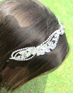 An close up image of the Alita Bridal Headband showing it placed in a brunette hair out style