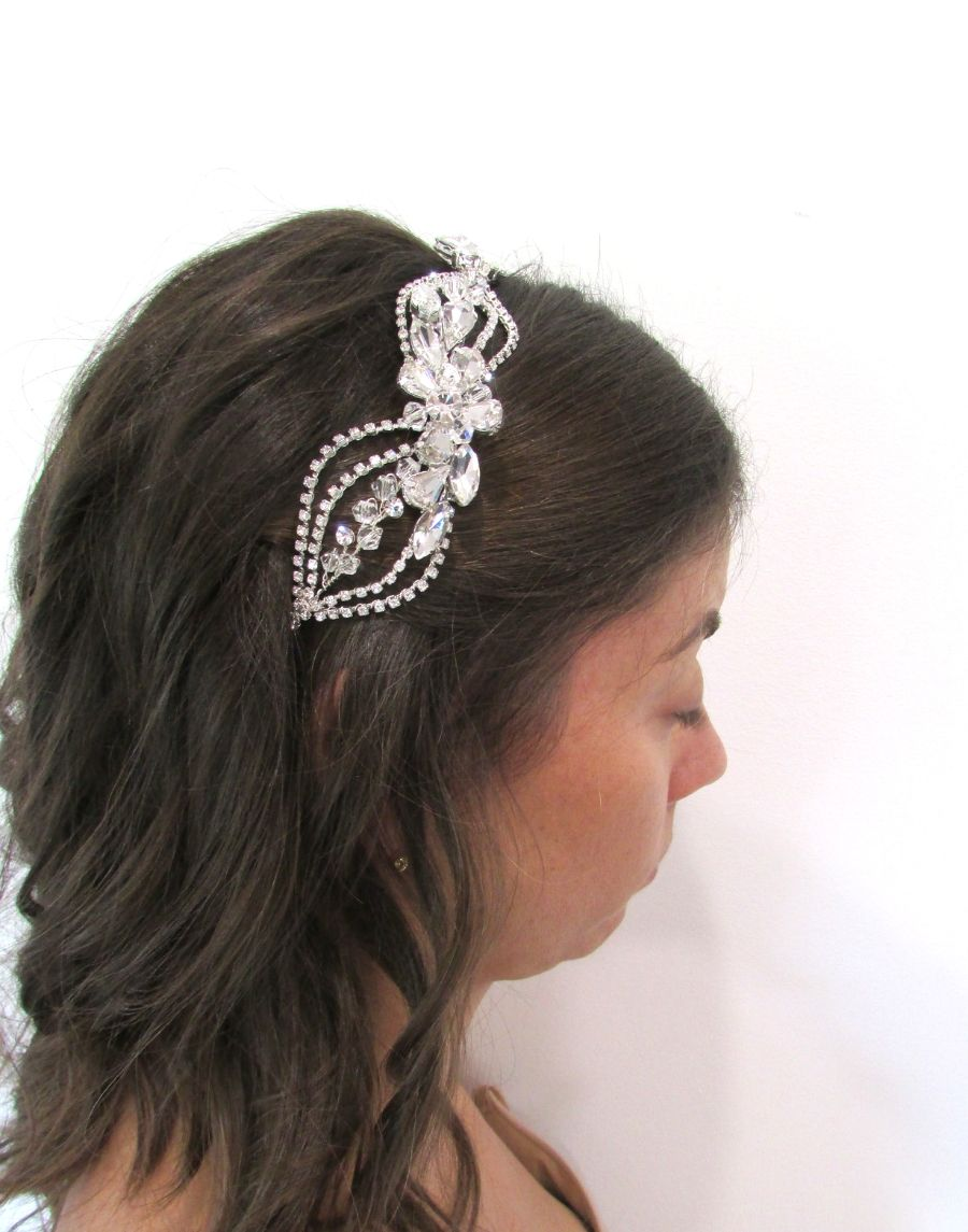 An image of the Alita Bridal Headband showing it placed in a brunette hair out style