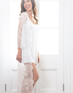 This image shows the Alma Lace Maxi robe placed over a simple white slip. The full length lace sleeves are ever so delicate and elegant. The robe falls the the floor making this robe a true masterpiece.