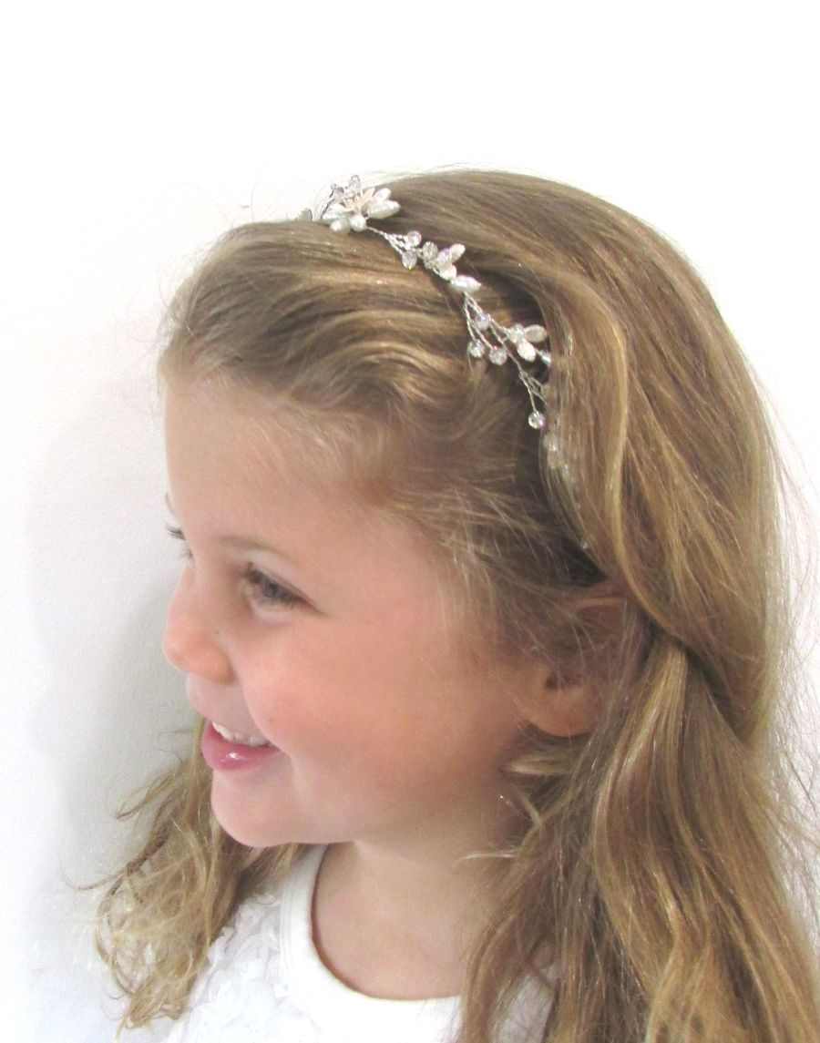 An image of the Ava Bridal Hair Vine Hairpiece showing it's placement on a blonde flowergirl's flowing hairstyle.
