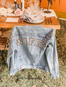 Load image into Gallery viewer, Vintage denim jacket on the back of a chair with WIFEY writing on the back of the jacket