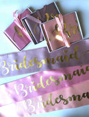 Load image into Gallery viewer, 3 maid of bridesmaid sashes in white boxes with ribbon around it and 3 bridesmaid satin sashes laying flat in soft peach,